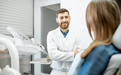 Cosmetic dentist and patient talking at initial consultation