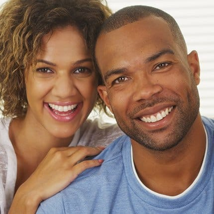 Man and woman with healthy smiles
