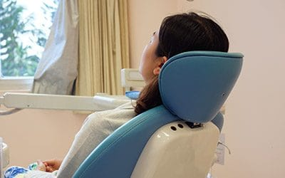 Patient in dental exam chair