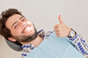 man thumbs up dentist